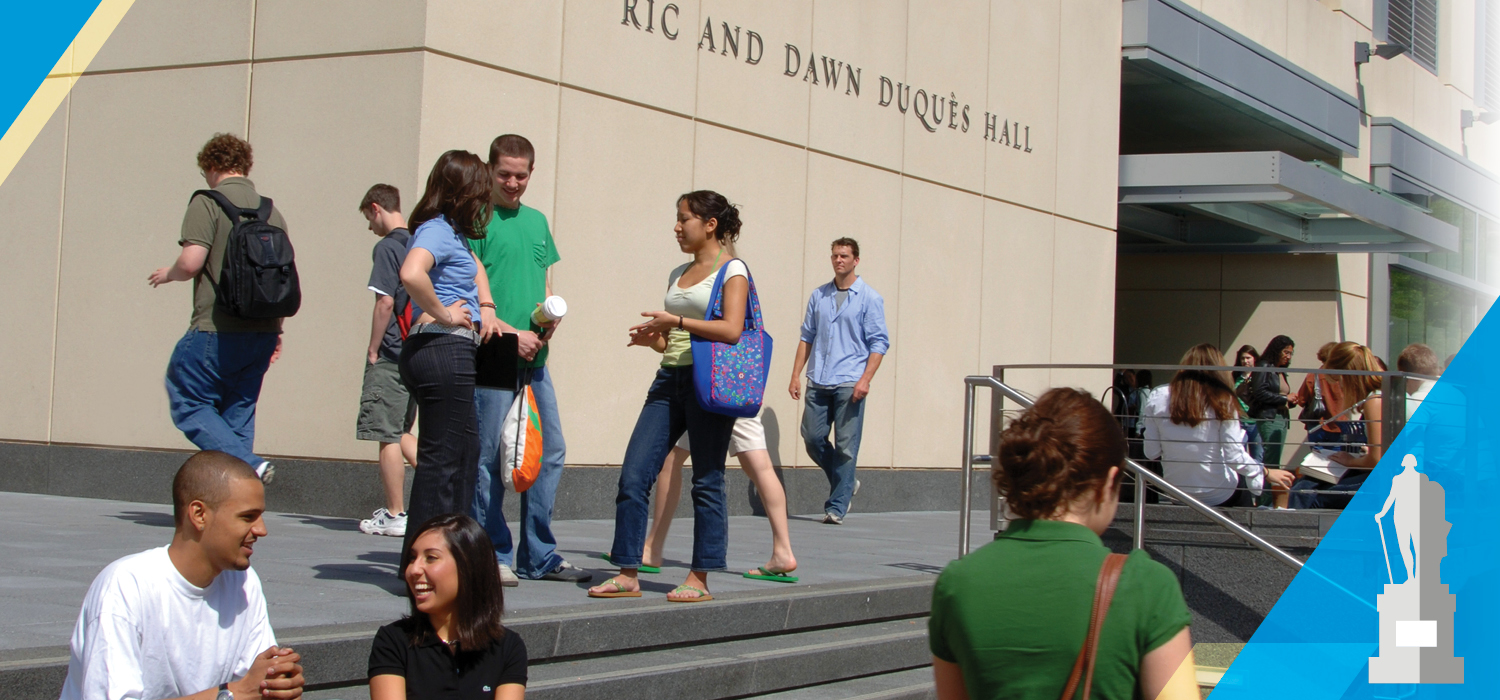 Students gathering outside of Duques Hall, the home of GWSB
