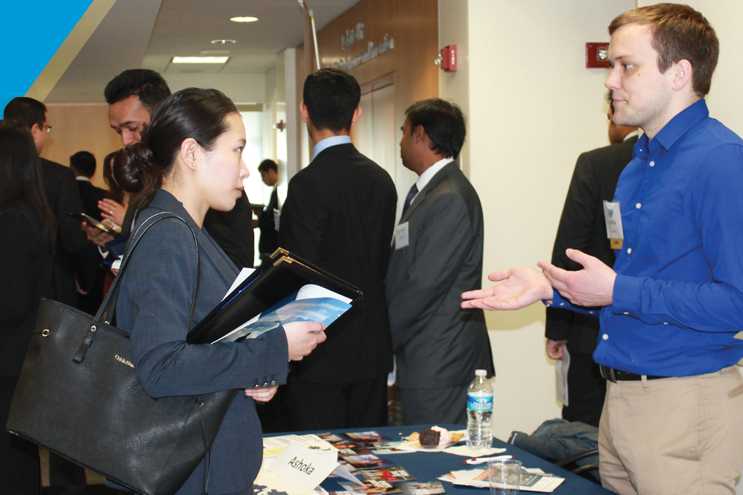 Student and employer talking at career fair