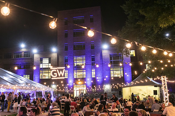 photo - alumni gather at an outdoor party during Colonials Weekend at GW
