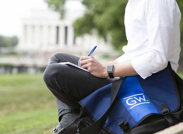 photo - A GWSB student takes a study break at the Lincoln Memorial in Washington, D.C.