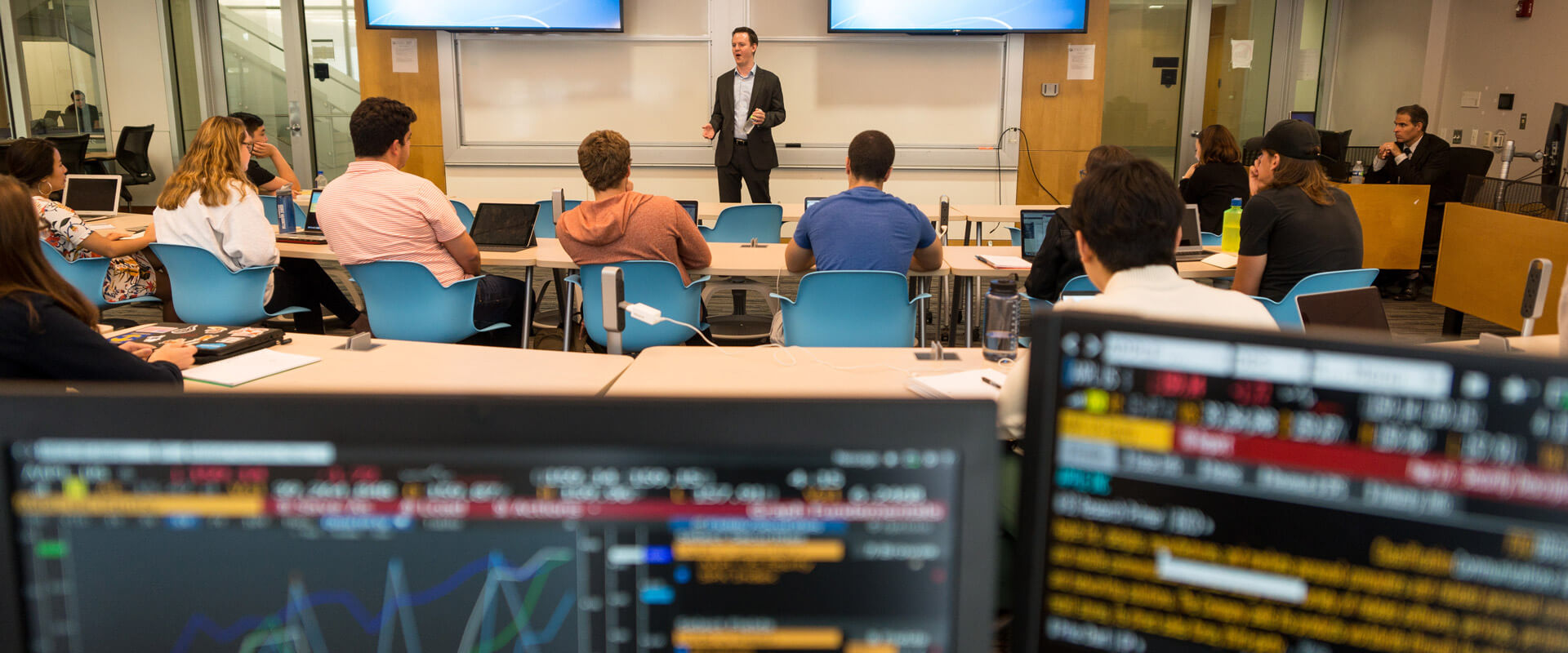 Students work on Bloomberg Terminals in the Capital Markets Room at GWSB