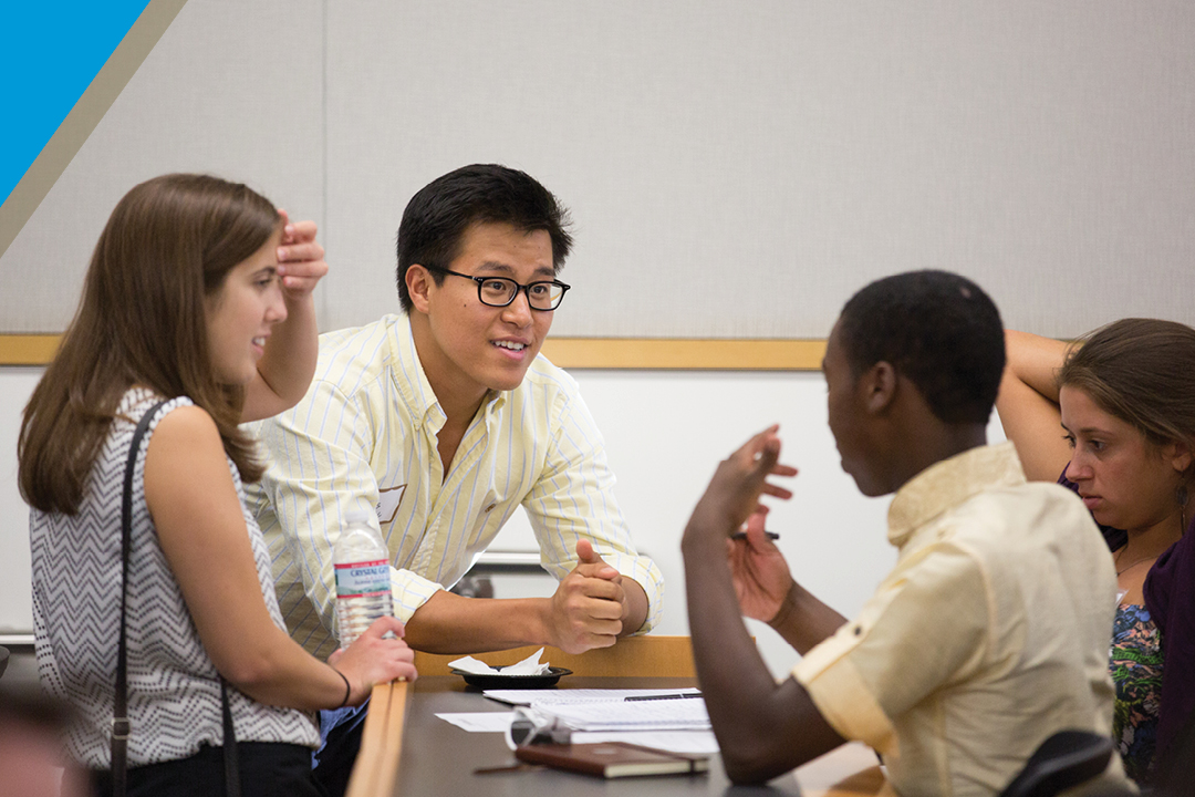International students meet with an advisor