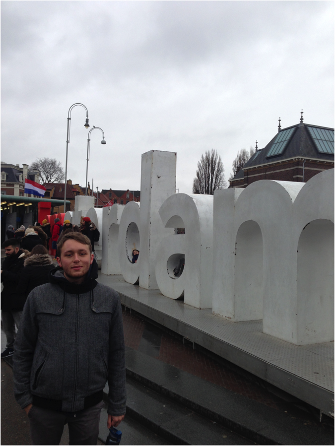 Walker Smith stands in front of the Amsterdam sculpture