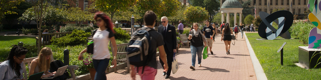photo - graduate admissions page hero image - GW students walk across campus