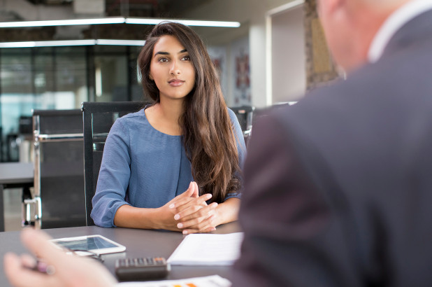photo - A woman participates in a case interview with an employer