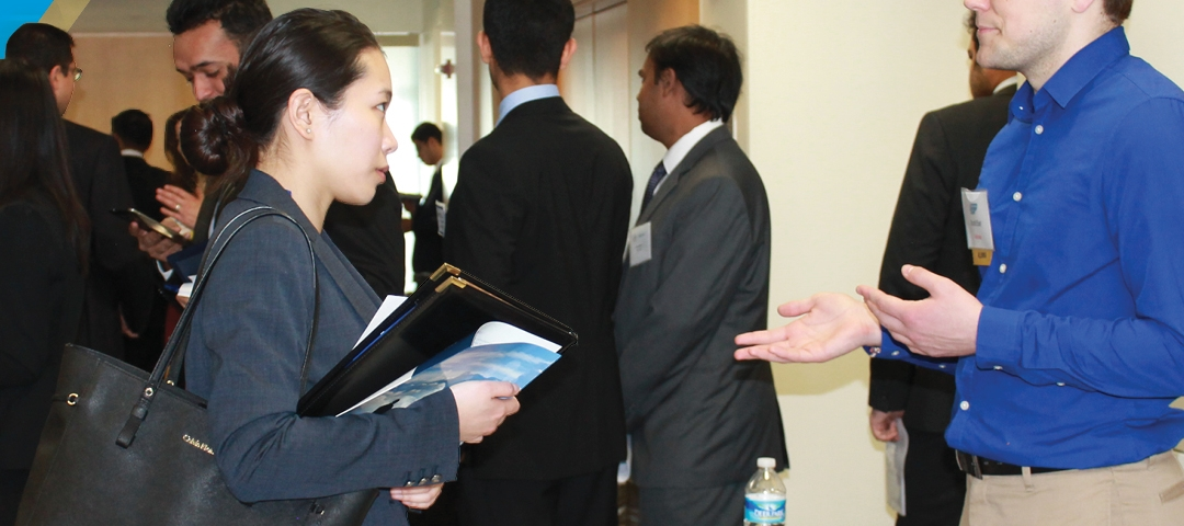 students discuss opportunities at a GWSB Career Center event