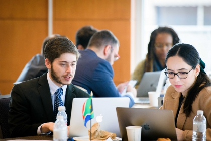 photo - students break into work groups at the 2020 Consulting Abroad Program Kick-Off event